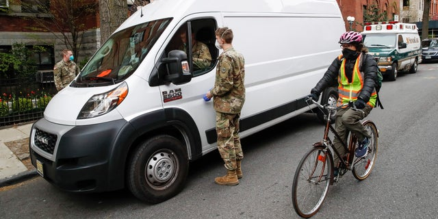 National Guard members arrive at Cobble Hill Health Center April 17, in the Brooklyn borough of New York. (AP Photo/John Minchillo)