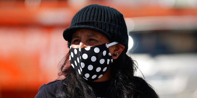 Jeanette Vizguerra wears a face mask during a car protest calling for the release of detainees at the GEO Immigration Detention Center because of the dangers posed by the new coronavirus Friday, April 17, 2020, in Denver. (AP Photo/David Zalubowski)