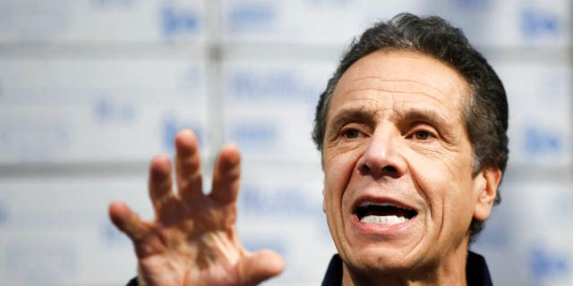 In this March 24, 2020, file photo, New York Gov. Andrew Cuomo speaks during a news conference at the Jacob Javits Center in New York.