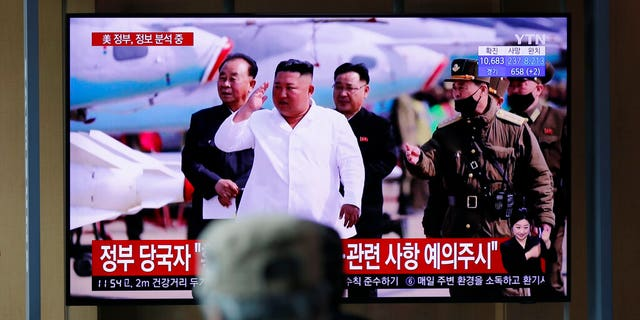 People watch a TV screen showing a news program reporting about North Korean leader Kim Jong Un with a file image at the Seoul Railway Station in Seoul, South Korea, Tuesday, April 21, 2020. The South Korean government is looking into unconfirmed reports saying North Korean leader Kim is in fragile condition after surgery.