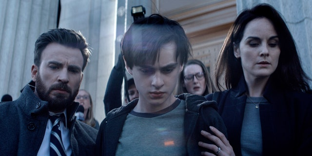 Chris Evans (L), Jaeden Martell (C), and Michelle Dockery (R) in a scene from 'Defending Jacob.'