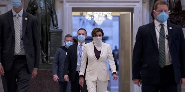 House Speaker Nancy Pelosi of Calif. walks to the House Chamber to vote on the nearly $500 billion Coronavirus relief bill on Capitol Hill, Thursday, April 23, 2020, in Washington. (AP Photo/Andrew Harnik)