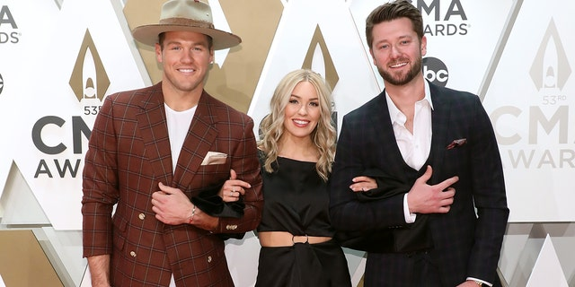 Colton Underwood (left), Cassie Randolph (center), and Adam Doleac (right) at the 53nd annual CMA Awards on November 13, 2019 in Nashville, Tennessee. (Photo by Taylor Hill/Getty Images)