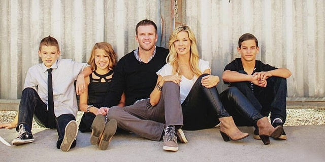 The photo of the Ancich family.