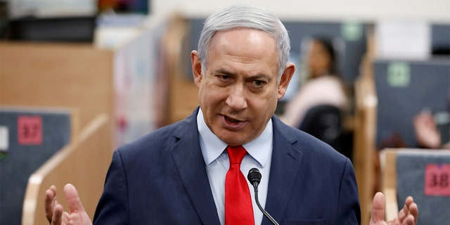 Israeli Prime Minister Benjamin Netanyahu gestures as he delivers a statement during his visit at the Health Ministry national hotline, in Kiryat Malachi, Israel last month. (REUTERS/Amir Cohen/File Photo)