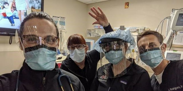 Medical workers posing with masks provided to them via MasksForDocs.