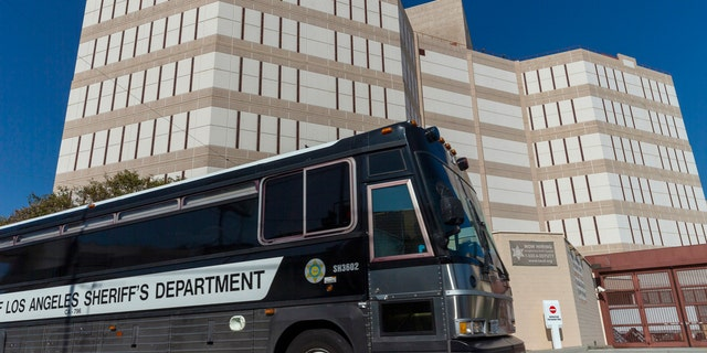 A Los Angeles County Sheriff's Department prisoner transportation bus leaves the Twin Towers Correctional Facility in Los Angeles on Wednesday, April 1, 2020.