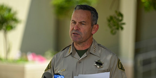 Riverside County Sheriff Chad Bianco addresses the media at a press conference, Friday, April 3, 2020, in Riverside, Calif. Bianco announced the passing of the second County Sheriff's employee to die due to the coronavirus. (Dylan Stewart/Image of Sport via AP)