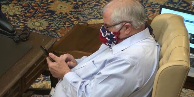 Michigan state Sen. Dale Zorn, a Republican, wearing a mask during a Senate vote Friday in Lansing (WLNS)