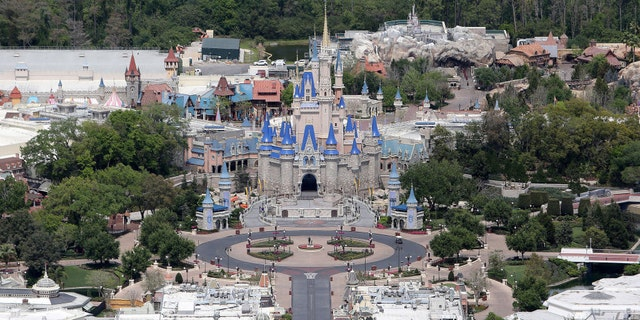 The Walt Disney World Resort is one of the Orlando attractions to reopen with health precautions in place. (Photo by Alex Menendez / Getty Images)