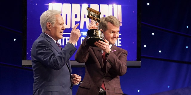 The late Alex Trebek is seen pictured here with Ken Jennings. Jennings is one of the first interim guest hosts on 'Jeopardy,' the show said on Monday. (Eric McCandless/ABC via Getty Images)