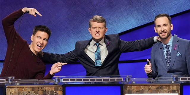 """James Holzhauer, Ken Jennings and Brad Rutter are pictured for the """"Jeopardy!: The Greatest of All Time"""" tournament."""
