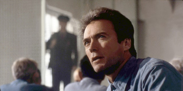 American actor Clint Eastwood on the set of 'Escape From Alcatraz,' directed by Don Siegel.