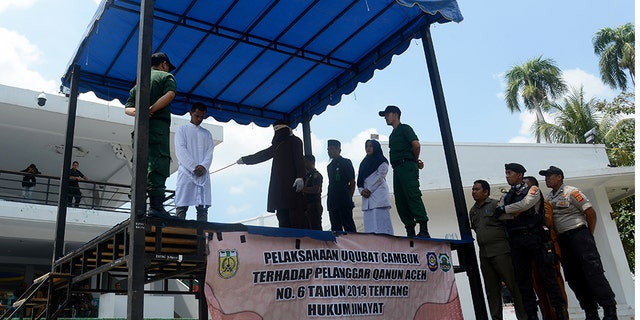 Sharia Service Officers give flogging to a man who violates Islamic Sharia law in Banda Aceh City.