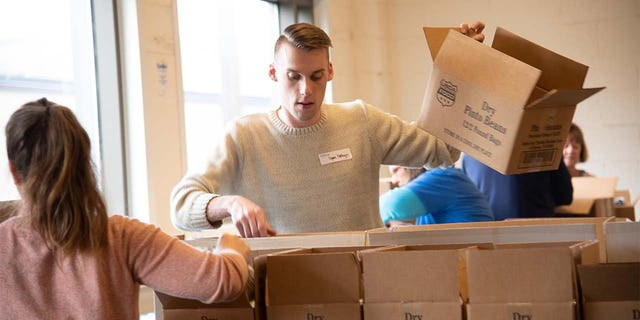Volunteers at Food Bank of the Southern Tier in Upstate New York packing emergency food boxes and bagging produce for drop and go delivery at Mobile Food Pantry sites and for distribution through regional school districts. (Feeding America)