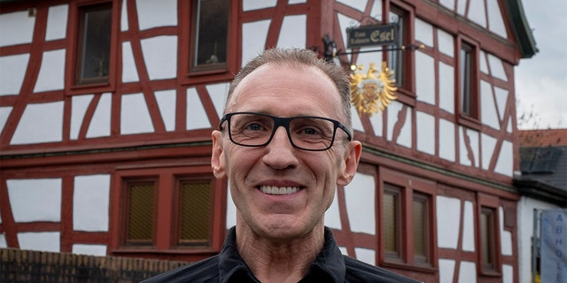 Thomas Metzmacher made some changes to his apple cider restaurant, Zum Lahmen Esel, in Frankfurt, Germany. (AP Photo/Michael Probst)