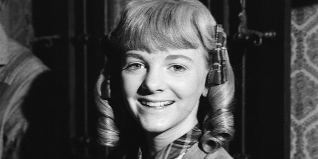 Alison Arngrim as Nellie Oleson.