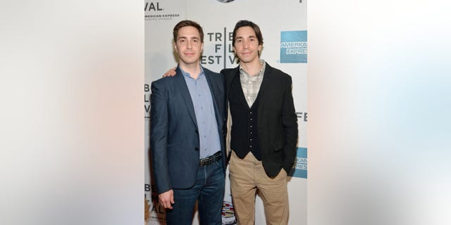 """Actor Justin Long (R) and his brother Christian Long attend the """"A Case Of You"""" World Premiere during the 2013 Tribeca Film Festival on April 21, 2013 in New York City."""