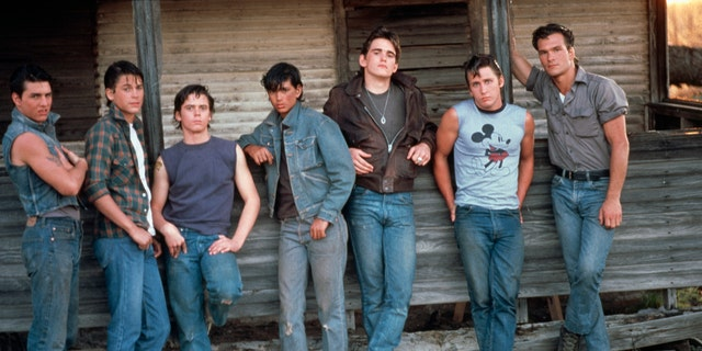 Tom Cruise, Rob Lowe, C. Thomas Howell, Ralph Macchio, Matt Dillon, Emilio Estevez and Patrick Swayze on the set of 'The Outsiders,' directed and produced by Francis Ford Coppola.
