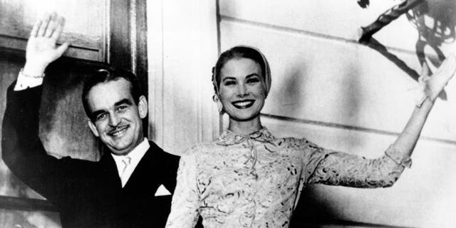 Prince Rainier III and actress Princess Grace Kelly wave from the palace terrace at Monaco in the South of France on April 18, 1956.