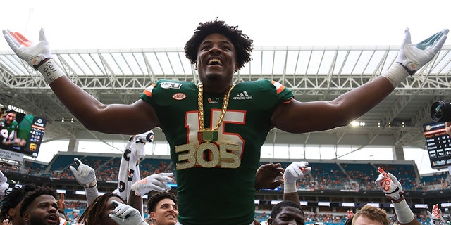 Sep 21, 2019; Miami Gardens, FL, USA; Miami Hurricanes defensive lineman Gregory Rousseau (15) celebrates wearing the turnover chain during the first quarter of a football game against the Central Michigan Chippewas at Hard Rock Stadium.
