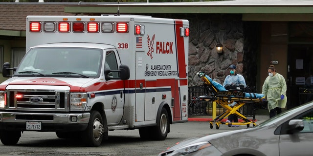 EMT's move a stretcher at the Gateway Care and Rehabilitation Center on Thursday, April 9, 2020, in Hayward, Calif. (AP Photo/Ben Margot)