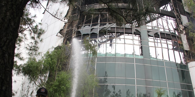 Firefighters were able to stop the church building from completely burning down Monday morning outside Jakarta.