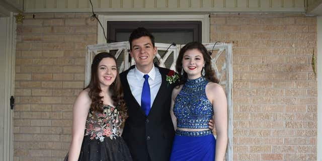 Grayson, left, is pictured with siblings Crae and Maura Chapman.