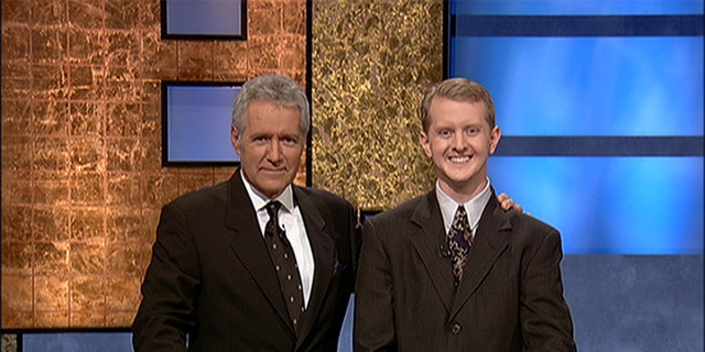 Jeopardy host Alex Trebek poses contestant Ken Jennings after his earnings from his record-breaking streak on the game show surpassed 1 million dollars July 14, 2004 in Culver City, Calif.