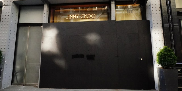 A view of a Jimmy Choo Boutique in Soho area boarded shut amid the coronavirus (COVID-19) outbreak on March 26, 2020 in New York City