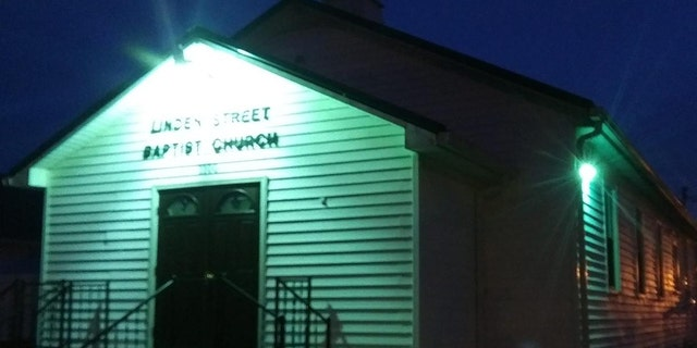 The Linden Street Baptist Church in Richmond, Ky., is lit up green to show compassion amid the coronavirus pandemic.