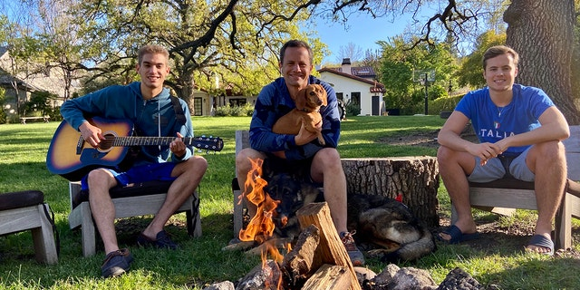 'Growing Pains' star Kirk Cameron is seen quarantining with his sons Luke, left, and James, right as the trio gather around a backyard campfire amid the coronavirus pandemic
