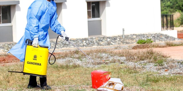 A laboratory staff disinfects box carrying COVID-19 test samples that were delivered via drone.