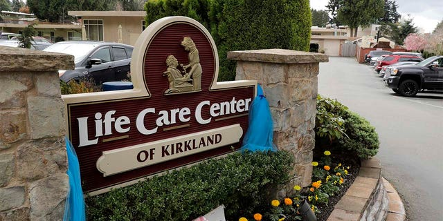 An entrance sign is shown at the Life Care Center in Kirkland, Washington. Federal authorities on Wednesday proposed a fine of more than $600,000 for the Seattle-area nursing home connected to the deaths of 37 residents. (AP Photo/Ted S. Warren)
