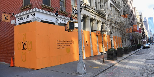 View of a boarded up Louis Vuitton storefront in the SoHo neighborhood of New York City on April 1, 2020. - The US on Wednesday has surpassed 200,000 confirmed cases of the novel coronavirus, according to a tally kept by Johns Hopkins University.