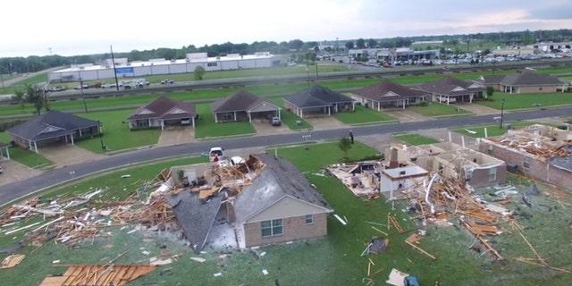 Drone video from the Monroe Fire Department showed several homes completely destroyed by a tornado, with roofs ripped complete off