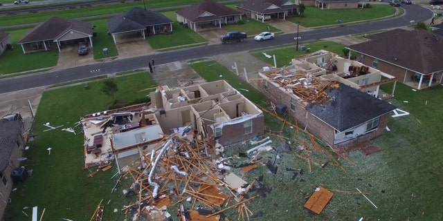 Drone video from the Monroe Fire Department showed several homes completely destroyed by a tornado, with roofs ripped complete off.