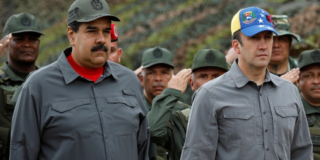 Venezuela's President Nicolas Maduro, Venezuela's Vice President Tareck El Aissami and Cilia Flores take part in a military exercise at Fuerte Tiuna military base in Caracas, Venezuela February 24, 2018. (REUTERS/Marco Bello)