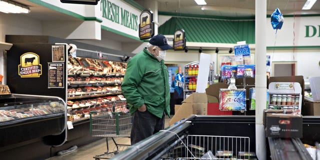 A shopper browses in the meat department at a supermarket in Princeton, Illinois, U.S., on Thursday, April 16, 2020. The Trump administration would like to make purchases of milk and meat products as part of a $15.5 billion initial aid package to farmers rattled by the coronavirus, said Agriculture Secretary Sonny Perdue.