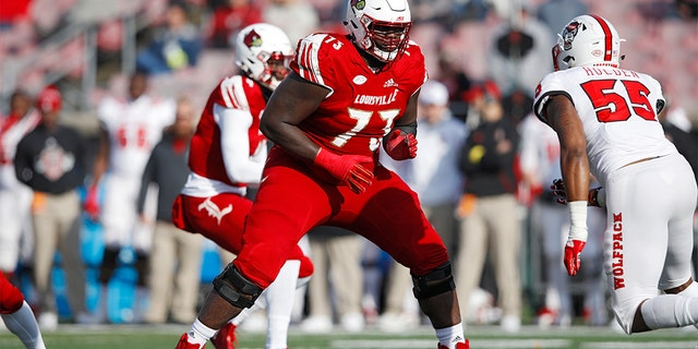 Mekhi Becton #73 of the Louisville Cardinals blocks against the North Carolina State Wolfpack during the game at Cardinal Stadium on November 17, 2018 in Louisville, Kentucky. (Photo by Joe Robbins/Getty Images)