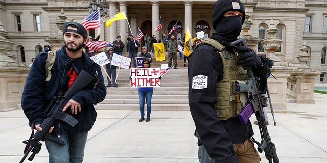 gardening Protesters carry rifles near the steps of the Michigan State Capitol building in Lansing, Mich., Wednesday, April 15, 2020. Flag-waving, honking protesters drove past the Michigan Capitol on Wednesday to show their displeasure with Gov. Gretchen Whitmer's orders to keep people at home and businesses locked during the new coronavirus COVID-19 outbreak.
