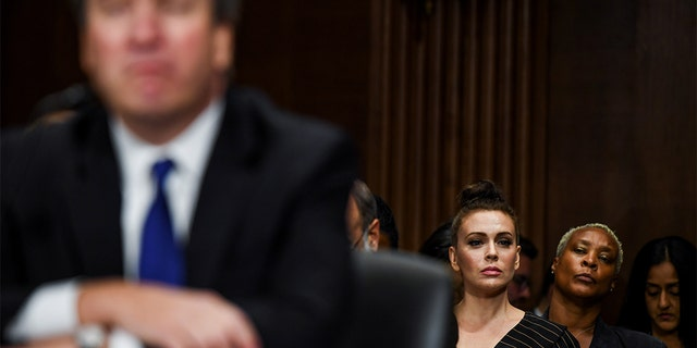 Actress Alyssa Milano watches a Senate Judiciary Committee hearing on Capitol Hill in Washington, DC, U.S., September 27, 2018. Matt McClain/Pool via REUTERS - RC13A7C2F350