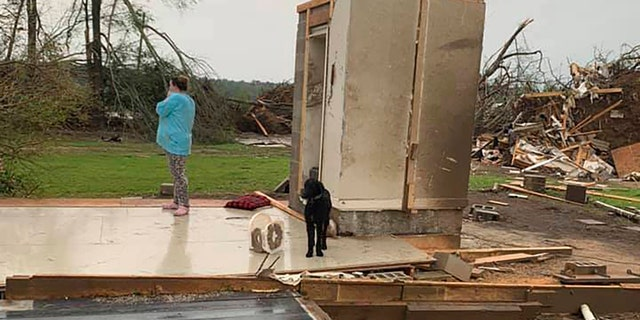 While the rest of their home was obliterated in a matter of seconds Sunday afternoon, Amber Phillip, her husband, Andrew, and their kids, ages 2 and 6 months, survived the storm without a scratch inside the small safe room, which doubles as a closet.