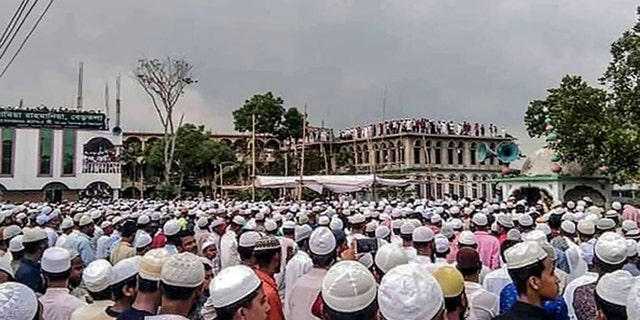 Muslim devotees attend a funeral prayer for an Islamic preacher during a government-imposed nationwide lockdown as a preventive measure against the COVID-19 coronavirus, in Brahmanbaria also known as Sarail on April 18, 2020. - Tens of thousands of people defied a nationwide coronavirus lockdown in Bangladesh on April 18 to attend the funeral of a top Islamic preacher, even as authorities battle a surge in virus cases. (Photo by STR / AFP) / To go with 'BANGLADESH-PANDEMIC-ISLAM' (Photo by STR/AFP via Getty Images)