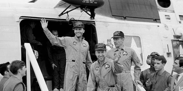 The Apollo 13 crewmembers step aboard the USS Iwo Jima, prime recovery ship for the mission, following splashdown and recovery operations in the South Pacific Ocean. Exiting the helicopter which made the pick-up some four miles from the Iwo Jima are (from left) astronauts Fred Haise, lunar module pilot; Jim Lovell., commander; and Jack Swigert, command module pilot.