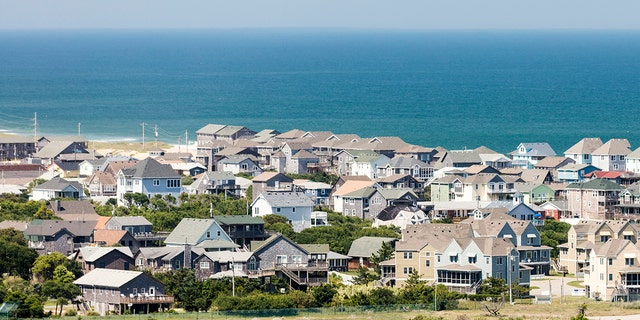 Wall to wall beach house packed into the town of Buxton near Cape Hatteras in the Outer Banks of North Carolina
