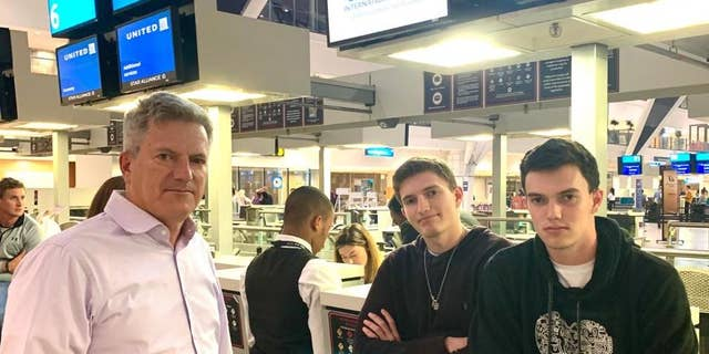 David Berman and his sons Jacob and Josh at the airport in Cape Town, South Africa. They had been on standby to leave on the last flight to New York before the country's coronavirus lockdown began.