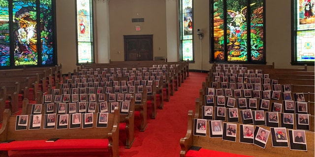 At First United Methodist Church in Huntsville, Texas, the pastor taped pictures of his members to the pews amid the coronavirus pandemic.