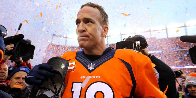 Peyton Manning # 18 of the Denver Broncos goes off the field after defeating the New England Patriots in the AFC Championship Game on January 24, 2016 at the Sports Authority ground in Denver, Colorado.  The Broncos defeated the Patriots 20-18.  (Photo by Justin Edmunds / Getty Image)