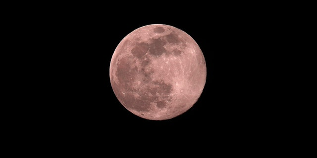 A super moon also called the pink moonwill be visible at around 11:32 p.m. on Monday.